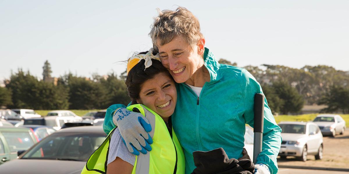 Secretary of the Interior Sally Jewell shares a joyful moment with Park Stewardship restoration intern Marcela Maldonado.
