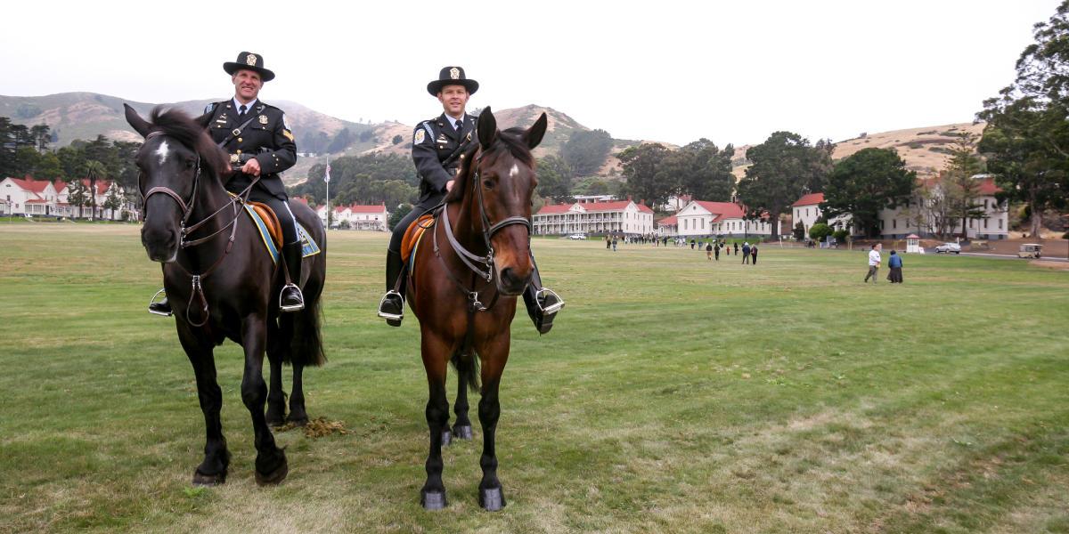 Policemen atop horses
