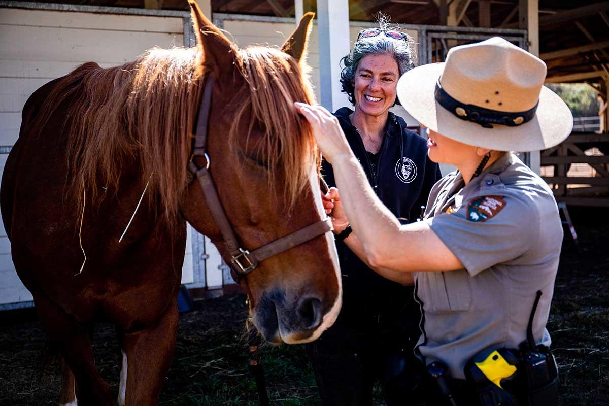 Lainie Motamedi and Park Ranger Katlyn Grubb at the Horse Mounted Patrol Stables in the Marin Headlands.