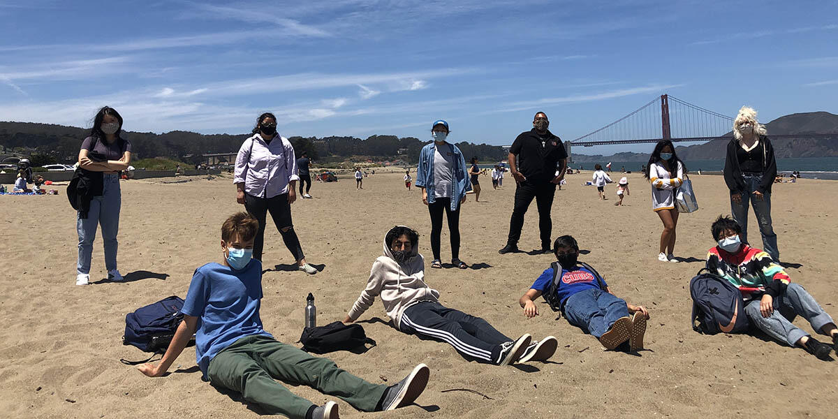 Youth who participated in the My Park Moment photo show curation on the beach near the Golden Gate Bridge.