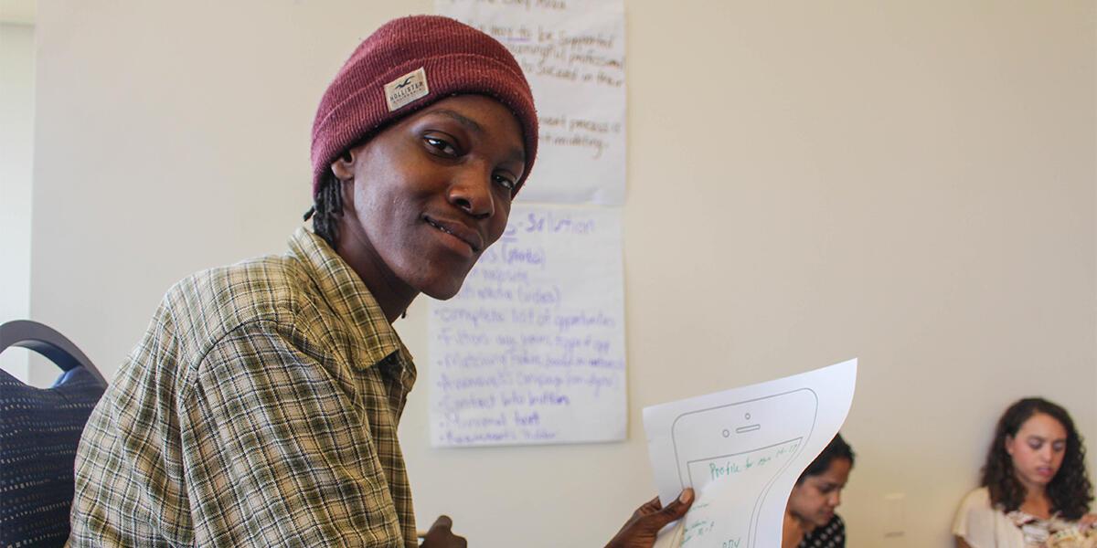 A student brainstorming a new website design