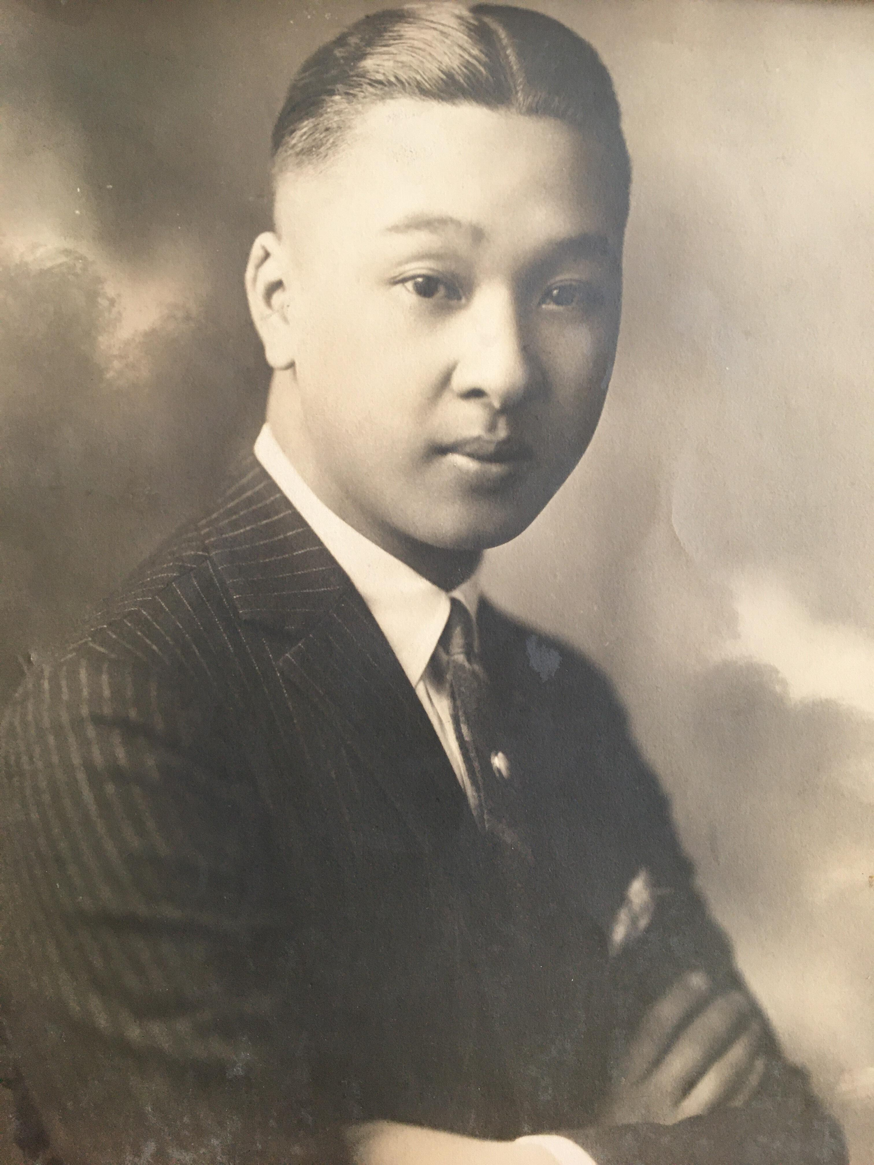 A sepia toned photograph from 1923 of Wallace Fong, a young Chinese-American man.