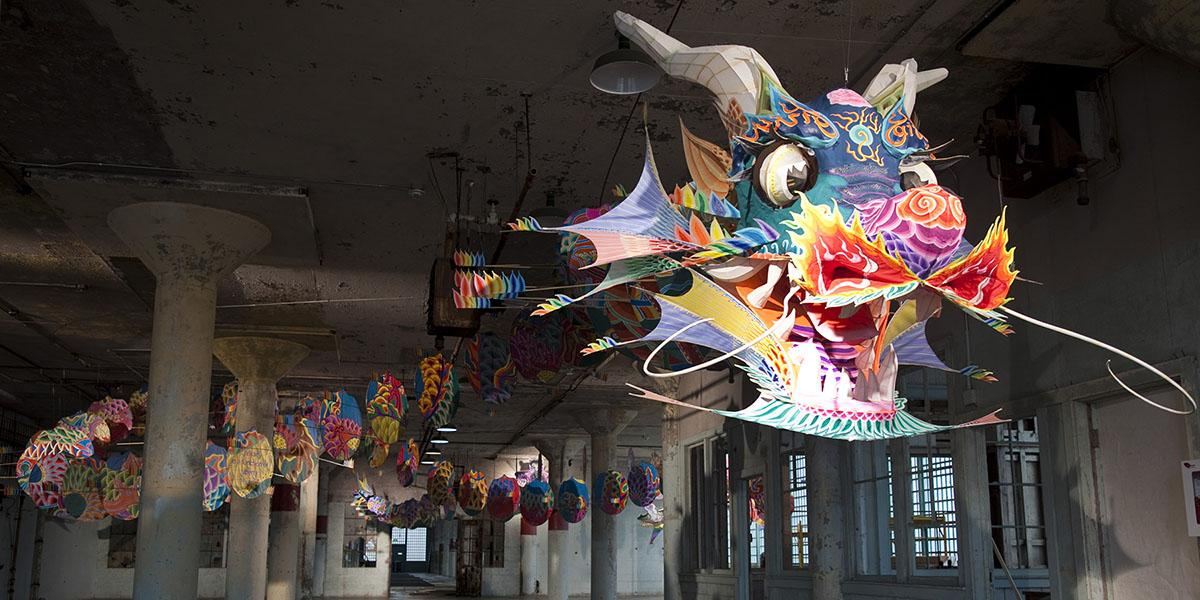 Colorful dragon suspended in an old Alcatraz prison building