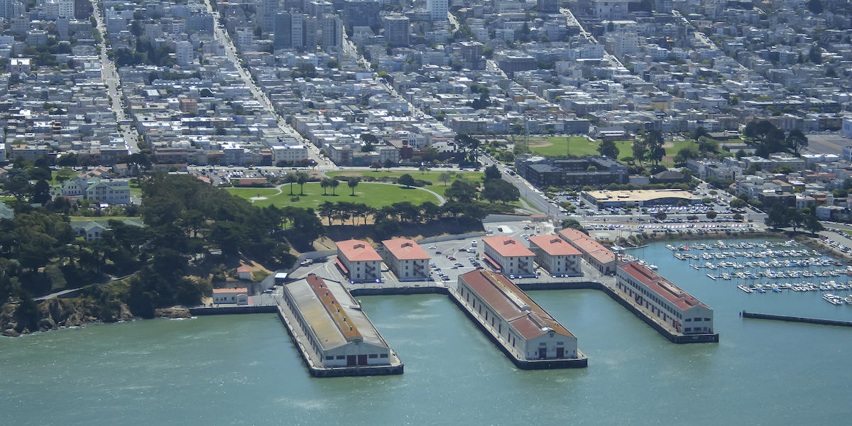 Aerial photo of Fort Mason, the San Francisco Bay, and the city.