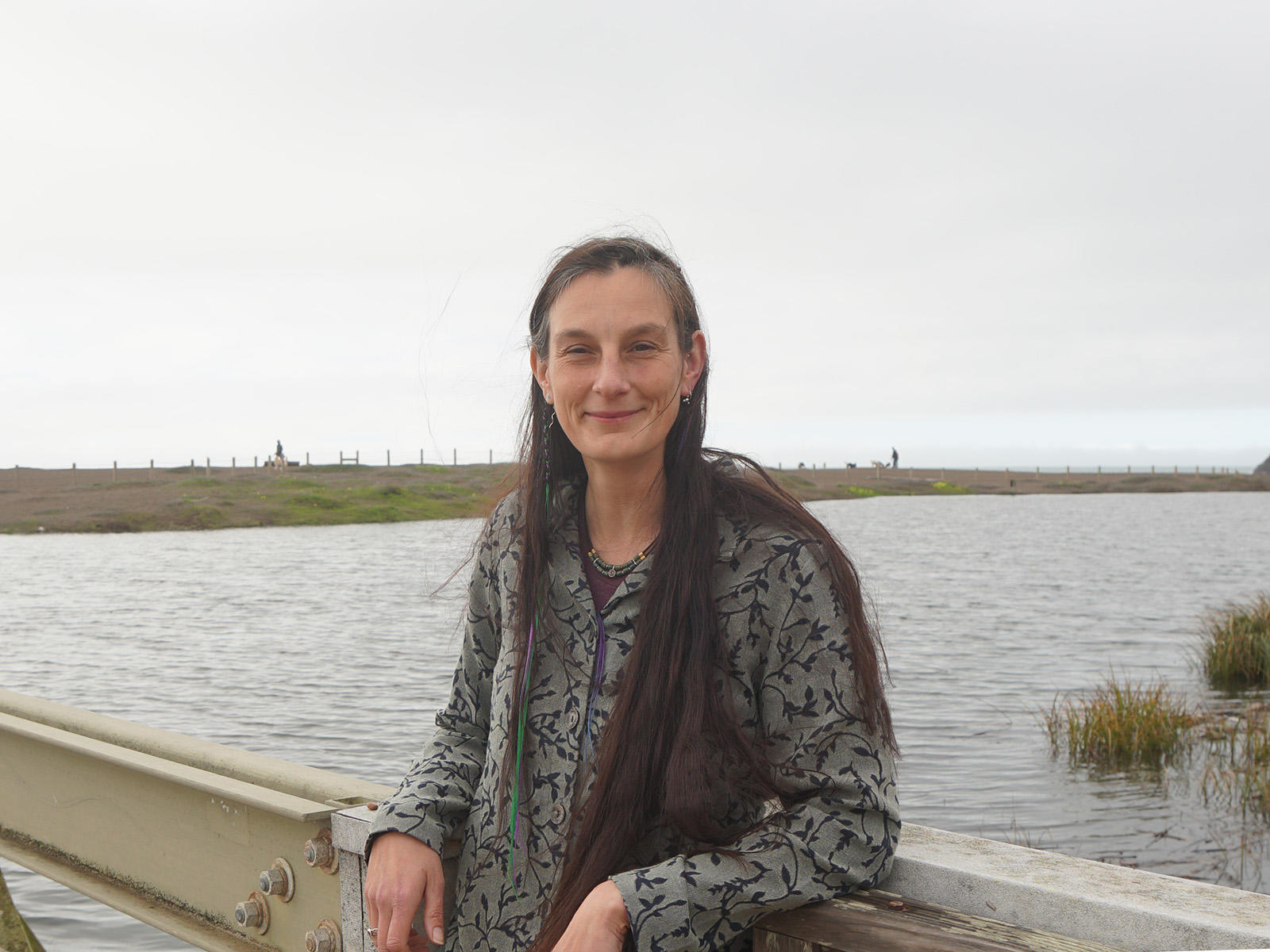 Portrait of Data manager Lizzy Edson smiling on the bridge by Rodeo Lagoon.