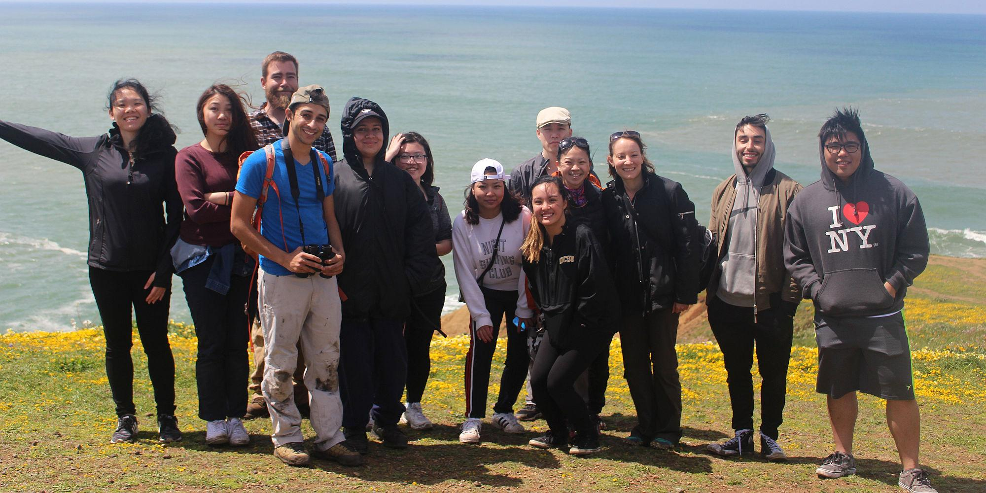City College of San Francisco students enjoy the wildflowers and sweeping views at Mori Point at the end of a fun program weeding