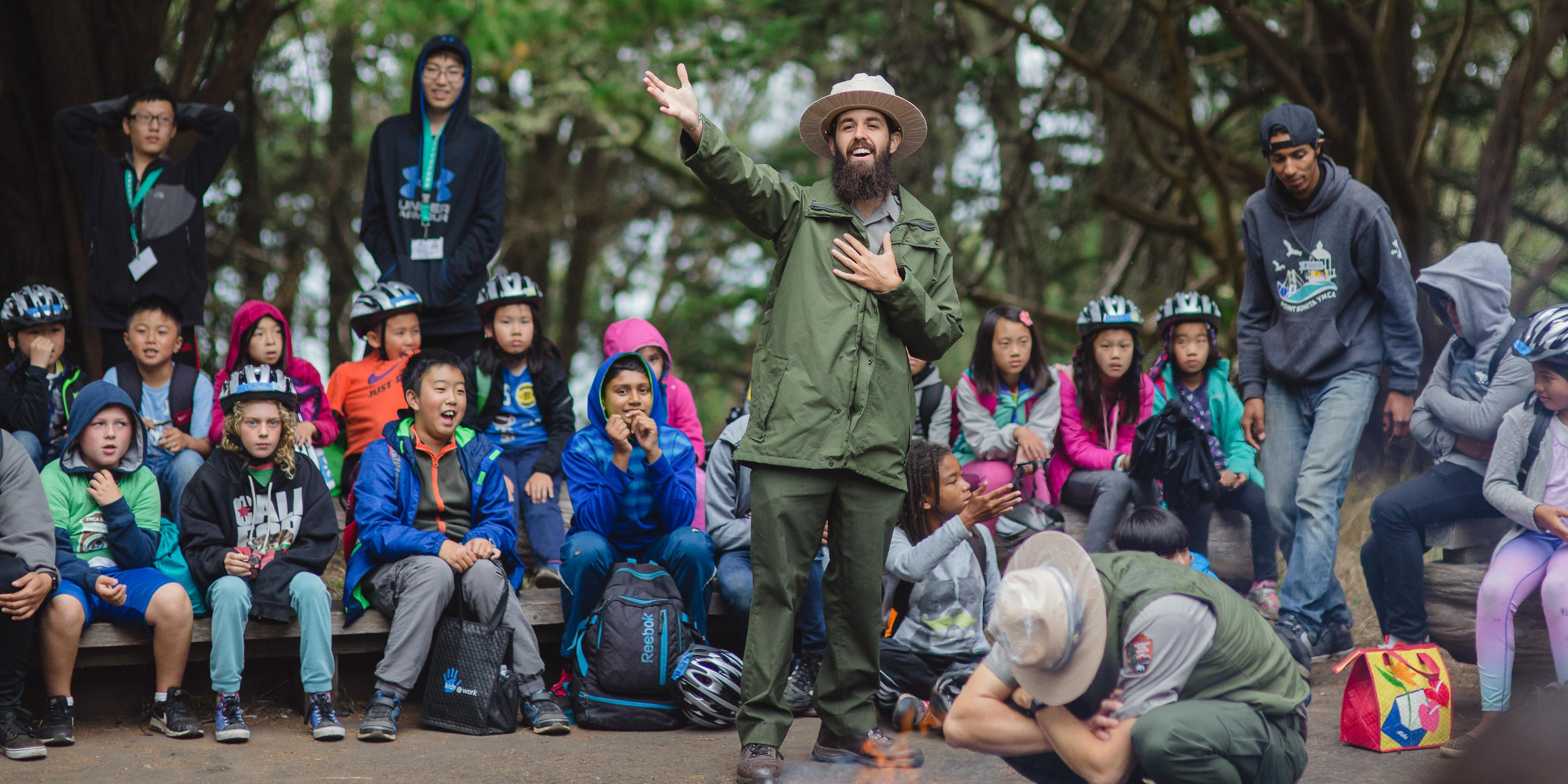 A national park ranger engages the youth