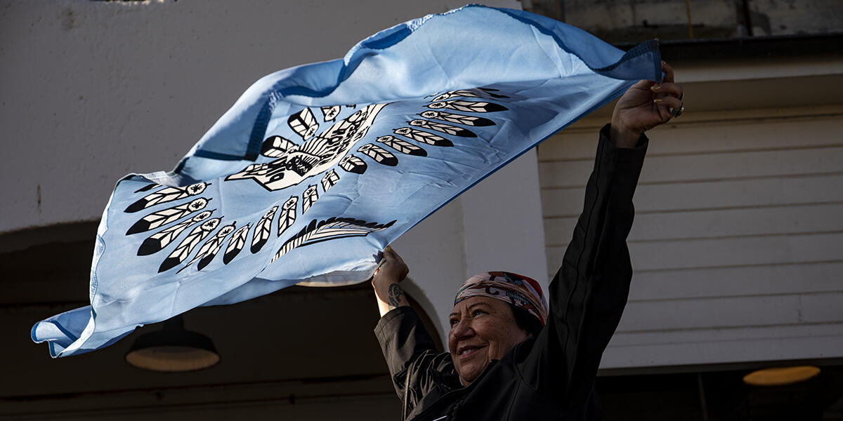 woman waves banner