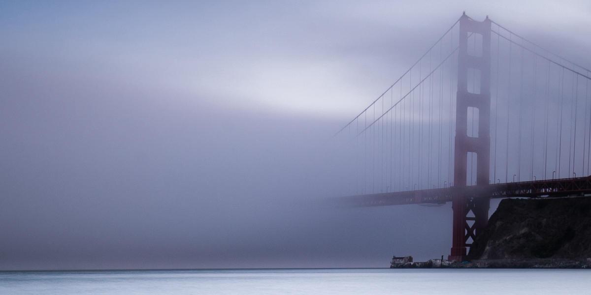 Golden Gate Bridge on a dark foggy day