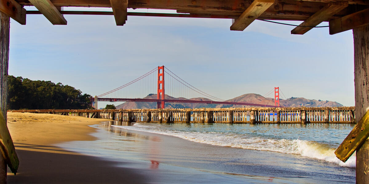 A view of the Golden Gate Bridge from beneath the pier of Crissy Field East Beach.