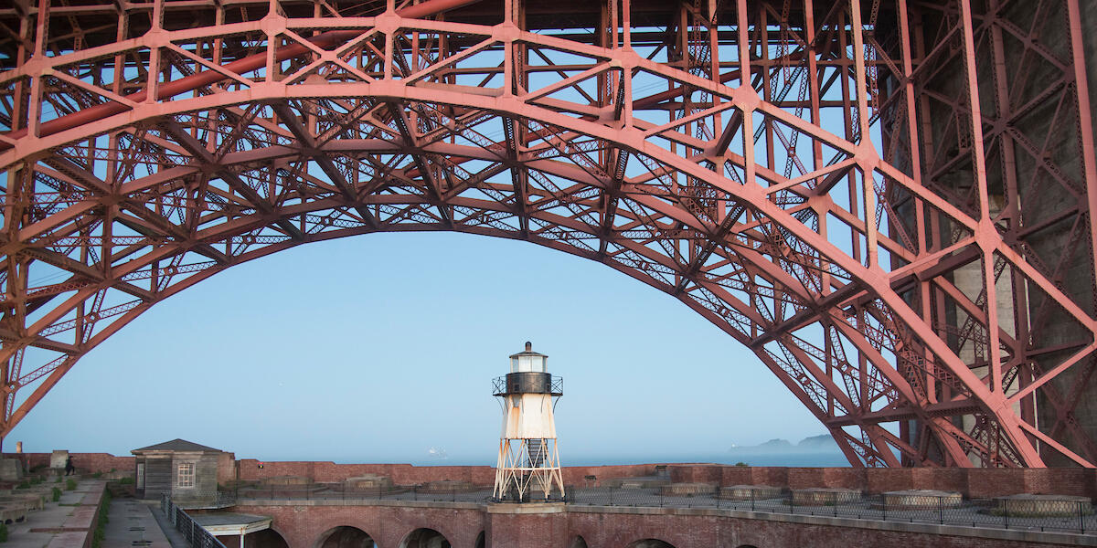 The arch of the Golden Gate bridge over Fort Point.