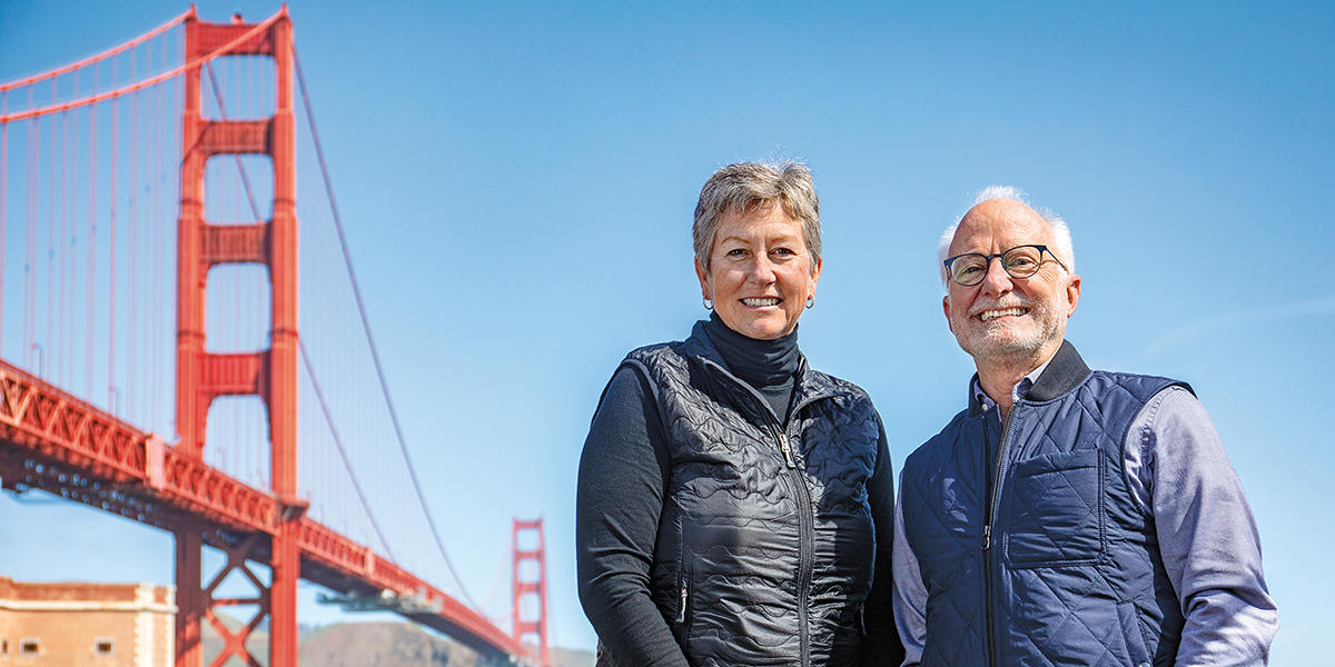Christine Lehnertz (left), current President & CEO of the Golden Gate National Parks Conservancy, and CEO Emeritus and Special Advisor Greg Moore (right) with Golden Gate Bridge in background.