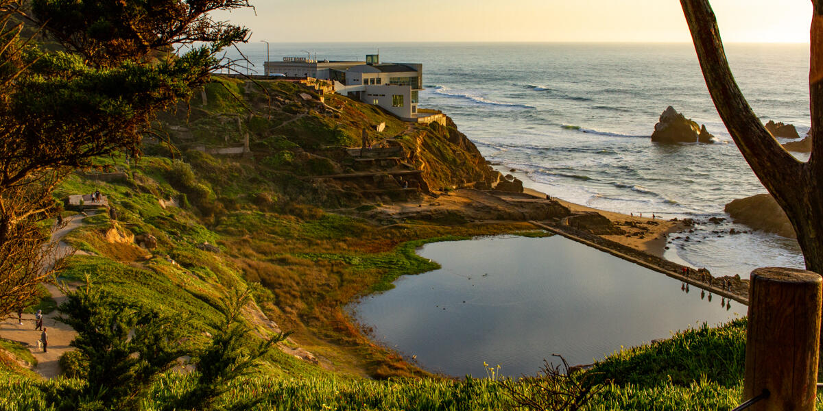 A sunset view overlooking Lands End, the ruins of Sutro Baths, and the ocean.
