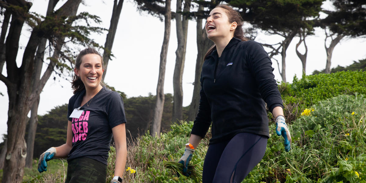 Volunteer laugh on hillside of Lands End.