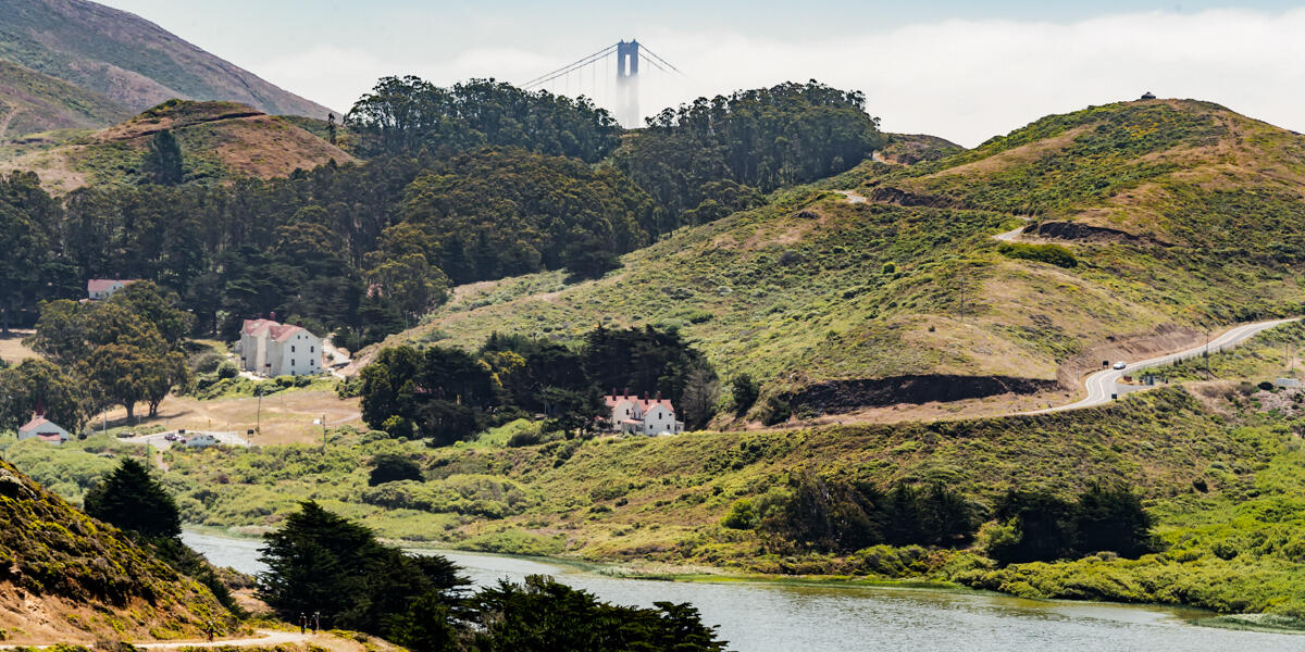 The Golden Gate Bridge peers over the mountains and into the valleys of the Marin Headlands.