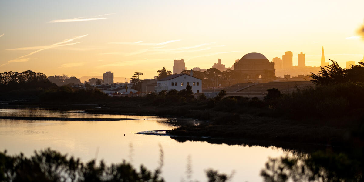 The sun rising over Crissy Marsh, beaming about the San Francisco skyline.