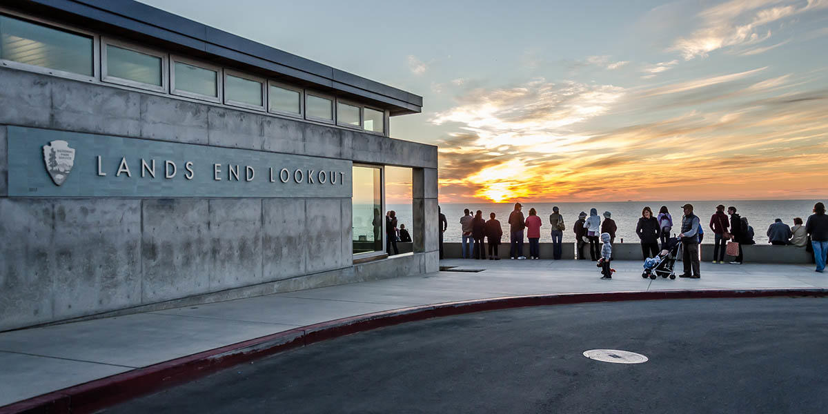 The outside of Lands End Lookout at sunset