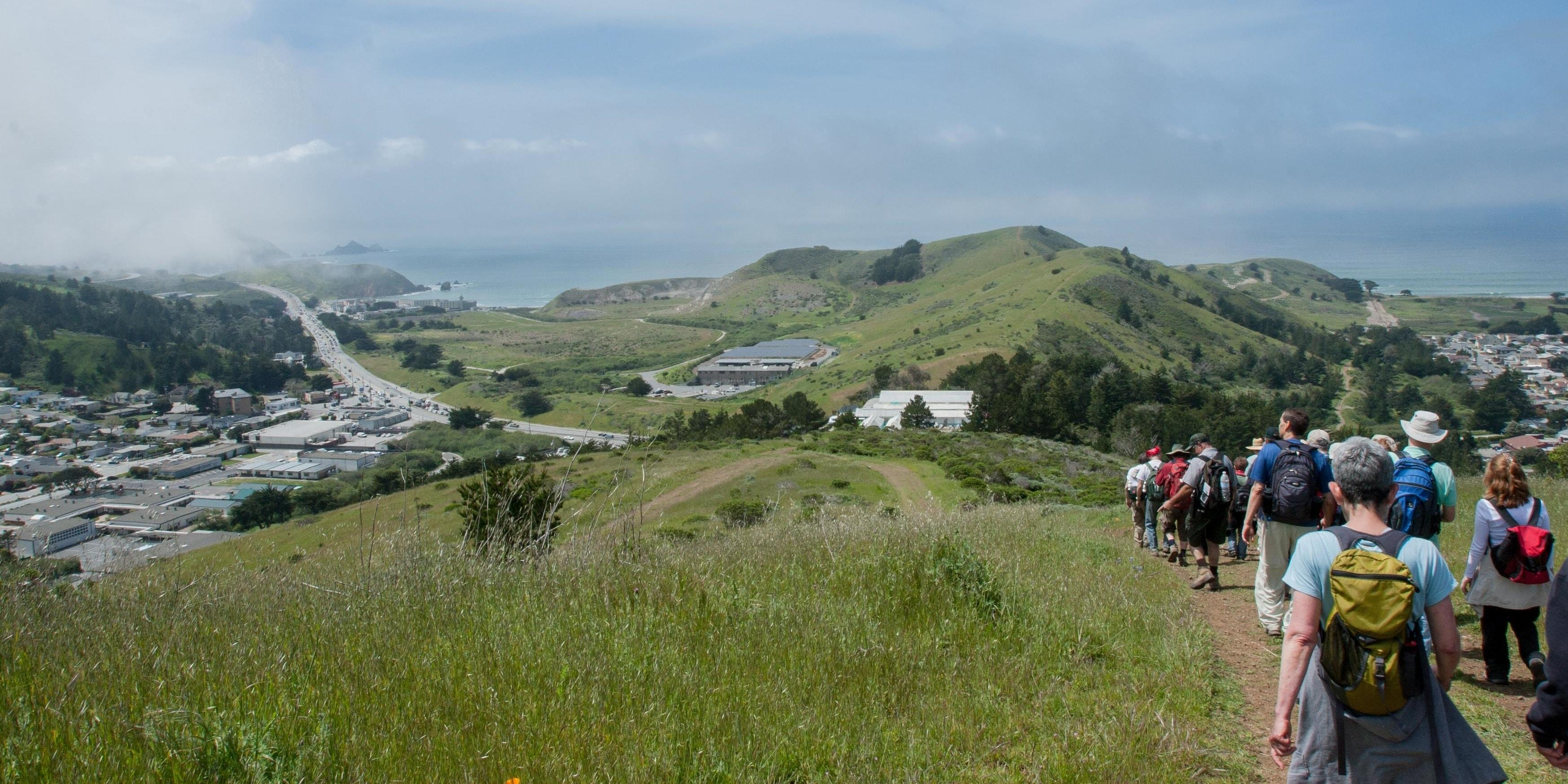 Hikers make their way down Sweeney Ridge