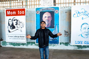 Artist Gregory Sale with some of the artwork at 'Future IDs at Alcatraz,' on display at the island through October.
