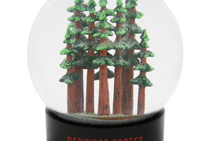 "Hand-painted coast redwood trees inside a fog globe. The globe bays says ""Redwood Forest, California""."