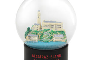 "Model of Alcatraz inside a fog globe. The globe's base says ""Alcatraz Island, San Francisco"""
