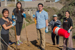 Teens Working on Batteries to Bluffs Trail