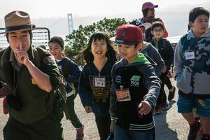Ranger Kelsi Ju leads a class of students in the Marin Headlands