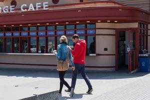 A couple walking toward the Bridge Cafe