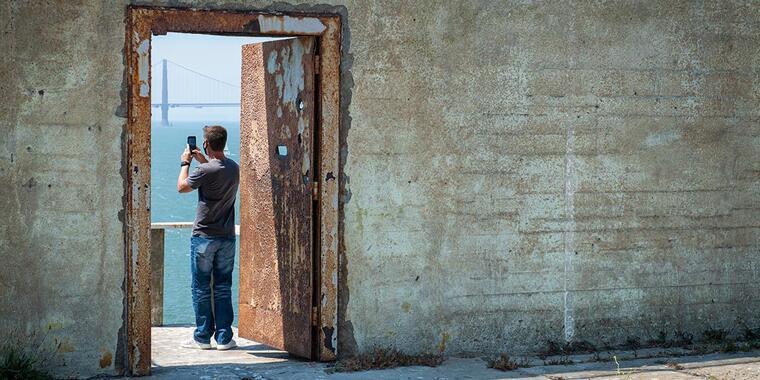 A visitor takes a photo on Alcatraz Island.