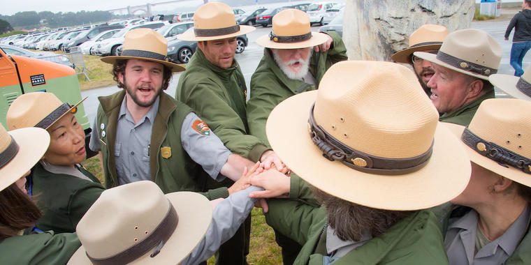 A group of NPS rangers rally together during the Junior Ranger Jamboree in 2016.