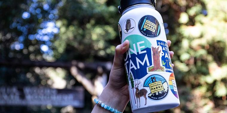 Water bottle covered in park stickers.