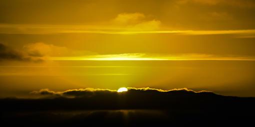 Sun breaking through storm clouds