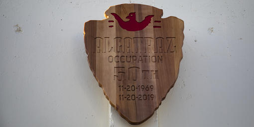 NPS arrowhead commemorating Alcatraz Occupation
