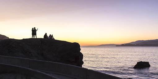People enjoying the sunset from China Beach