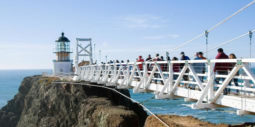 Visitors cross the bridge to Point Bonita Light
