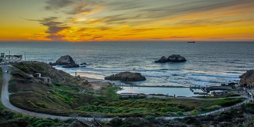 Colors of sunset wash over Sutro Baths