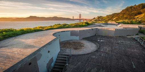 Image of a coastal battery with the Golden Gate Bridge in the distance