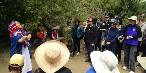 Park Ranger with a shuttle group at El Polin Springs.