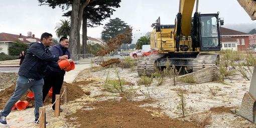 """Tossing dirt during the Tunnel Tops """"Groundmaking"""" event."""