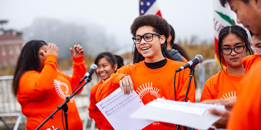High School students sing in youth choir at Presidio Tunnel Tops ground-making ceremony.