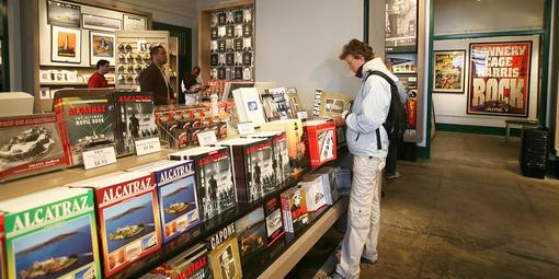 Customer looking at a Capone book in an Alcatraz Island store