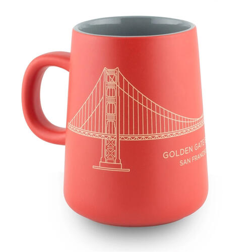 Red and gold tapered mug with a line drawing of the Golden Gate Bridge.