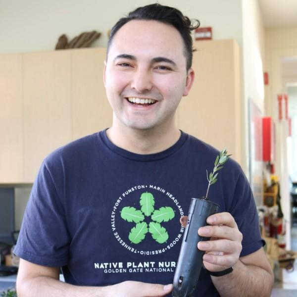 Brian Teng holding a potted manzanita